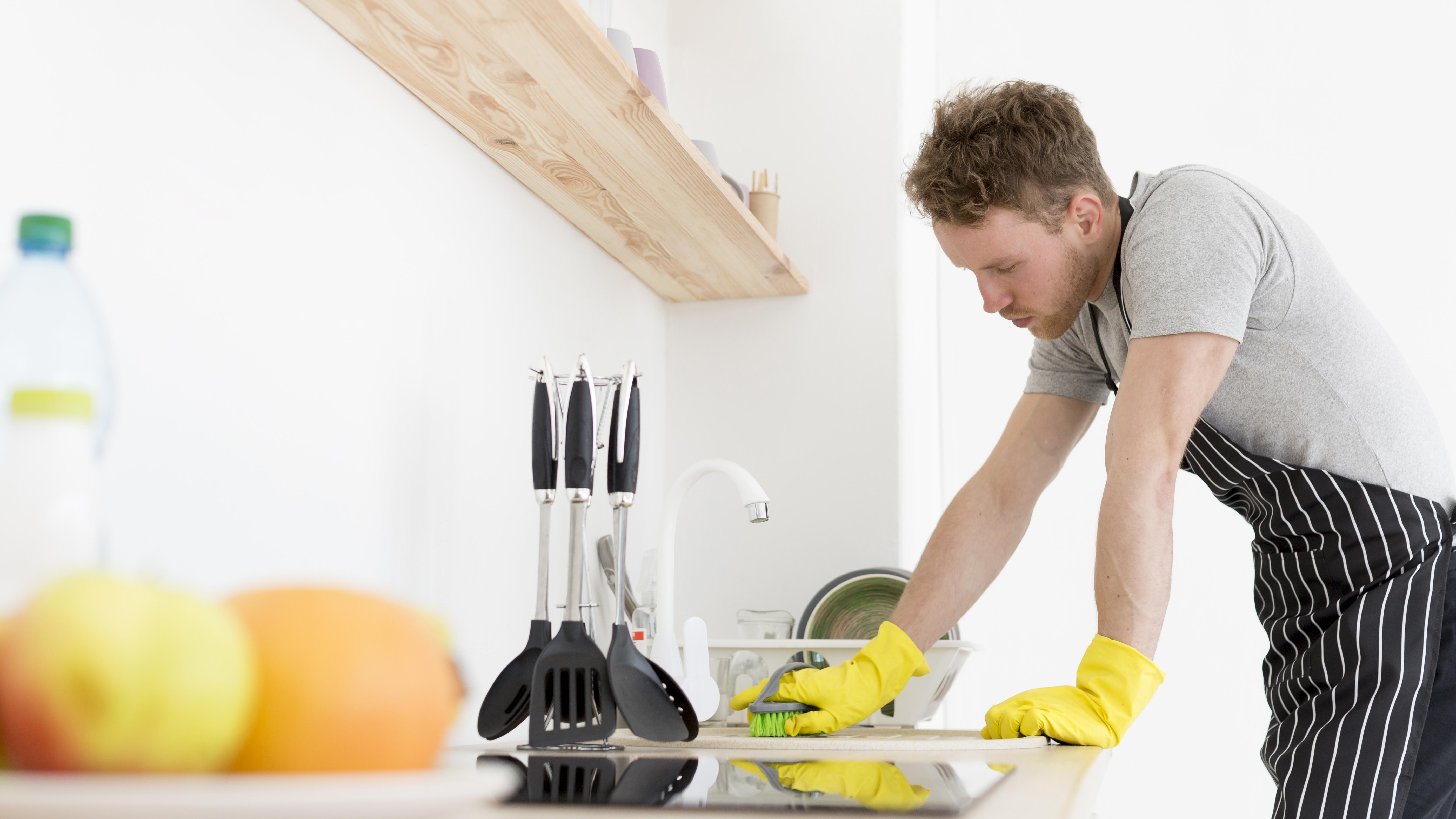 Man professional kitchen cleaning
