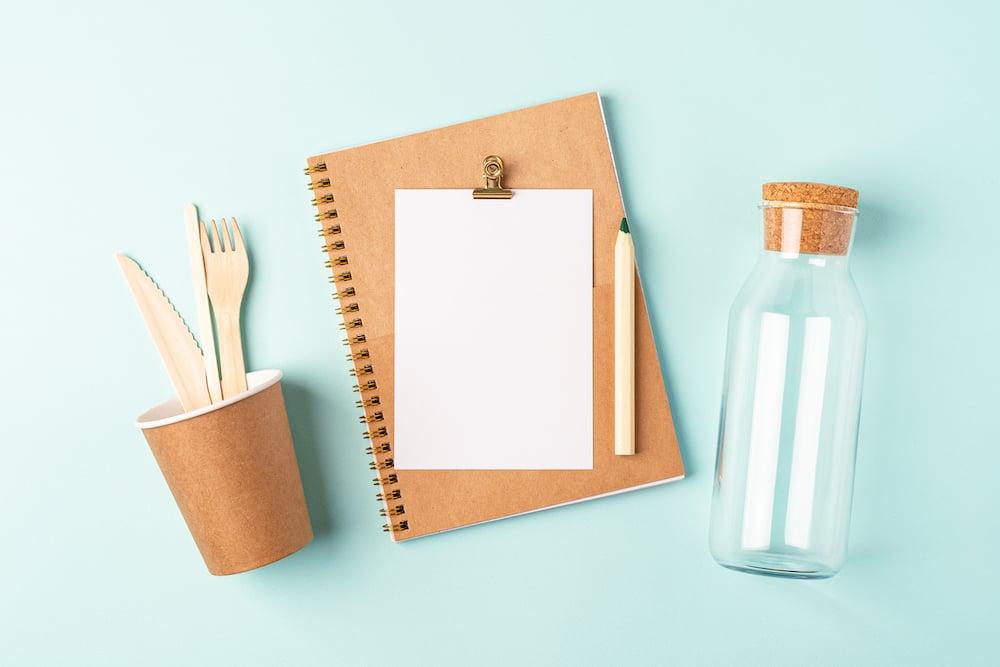 desktop-planner-flat-lay-blue-mint-table-top-view-glass-jar-coffee-cup